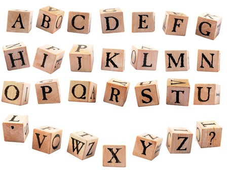 A complete set of rustic alphabet blocks A - Z plus an apostrophe and question mark   They are oriented differently to appear as if they are falling   Isolated on white