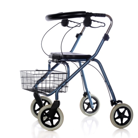 A wheeled walker with brakes, basket and seat isolated on white  Imagens