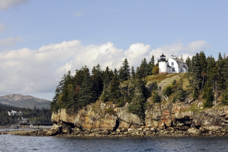 A scenic view of a Bar Harbor, Maine lighthouse on a beautiful autumn day  Taken from the water   Focus on the lighthouse