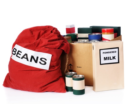 A large bag of beans, a box of powdered milk and multiple containers of non-perishable food to be given to the needy   Isolated on white Stock Photo - 13531589