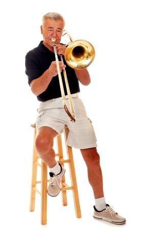 Senior man playing his trombone  Stock Photo