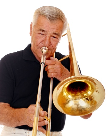 Close up of a senior man playing his trombone  Stock Photo - 13531590