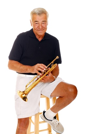 old people: Senior man with his trumpet Stock Photo
