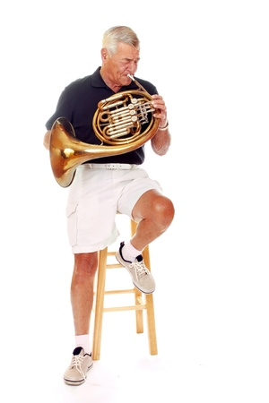 Senior man playing his French horn  Stock Photo - 13531497