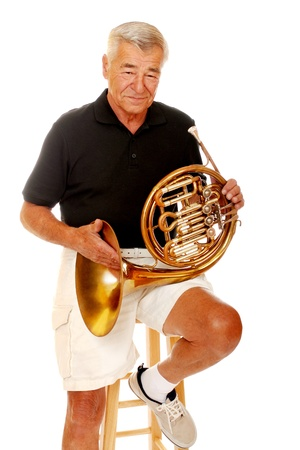 Senior man holding his French horn Stock Photo - 13531586