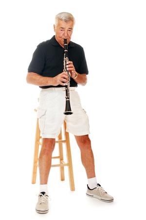 Senior man playing his clarinet  Stock Photo - 13531499