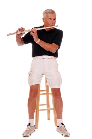 Senior man playing his flute  photo