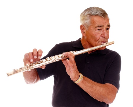 silver flute: Close-up of a senior man playing his flute