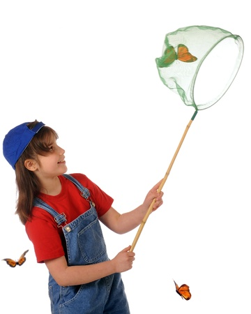 An elementary girl happy with her success in catching a large monarch butterfly in her net   Isolated on white  Stock Photo