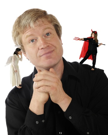 A mature man delightedly listening to an angel on one shoulder while a she-devil is preparing to spear him with her pitchfork on the other   Isolated on white