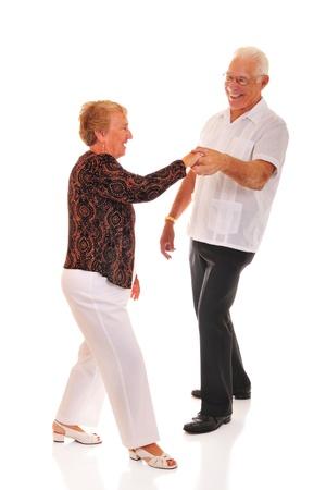 A jitterbugging senior couple   Isolated on white  photo