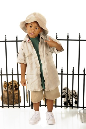 An adorable preschooler playing zookeeper with his toy animals    Foto de archivo