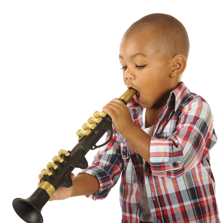 mouth opened: A handsome little boy, mouth opened wide, ready to blow on his toy clarinet   Isolated on white