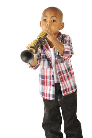 A handsome young African American tooting away on his toy clarinet   Isolated on white  Stock Photo - 13531533