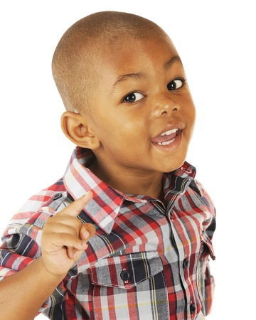 A handsome preschooler happily using his index finger when making his point  Stock Photo
