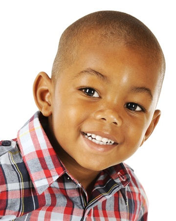 Closeup portrait of a happy African American preschooler on a white background  Stock Photo