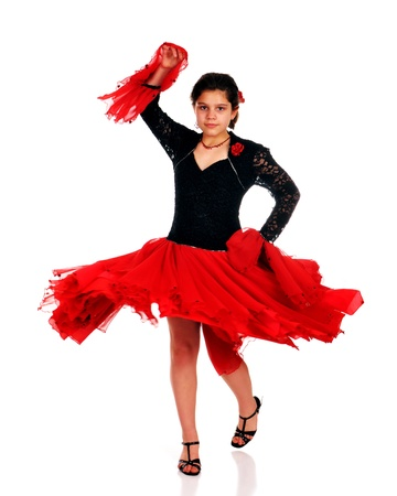 Preteen girl twirling while dancing the Latin Pasa Doble   Isolated on white  Stock Photo