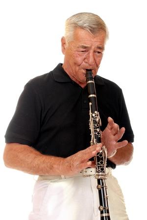 Senior man playing his clarinet Stock Photo - 13531517