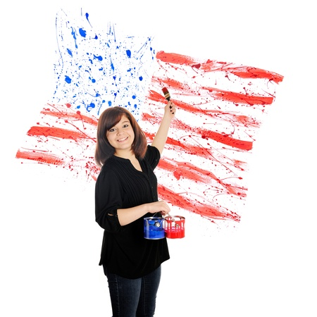 A beautiful young teen splashing red and blue paint against a white background to create an American flag Stock Photo - 13569389