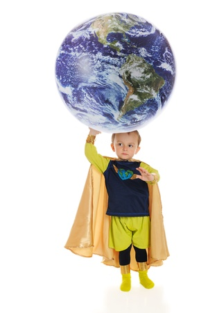 A preschool superhero,  Planet Man,  holds up the world with his hand   On a white background   photo
