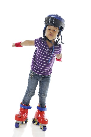 roller blade: An adorable preschooler holding her arms out as if in flight as she gains confidence on her plastic roller blades   On a white background