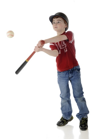 A young elementary baseball batter hitting the ball   Motion blur on bat and ball   On a white background  photo