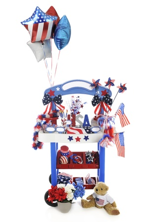 braclets: A vendor stand stocked for celebration sales on the Fourth of July.  The stands signs are left blank for your text.  On a white background.