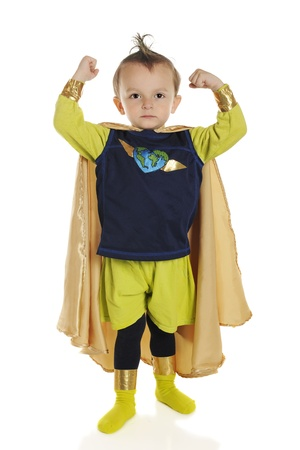 Full length portrait of a tiny superhero showing his muscles   On a white background