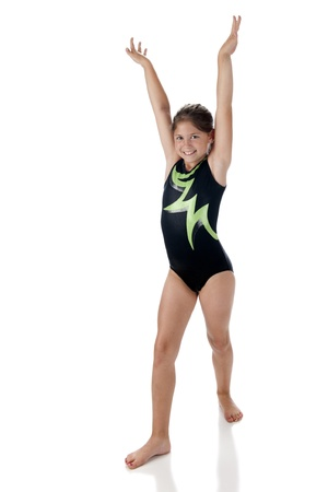 dismounted: A beautiful elementary gymnist in dismounted position   On a white background  Stock Photo