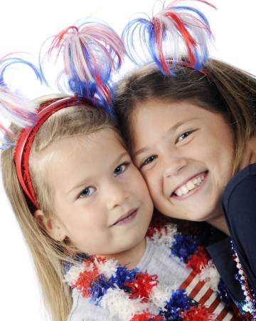 leis: Closeup image of two sisters a decked out to celebrate America