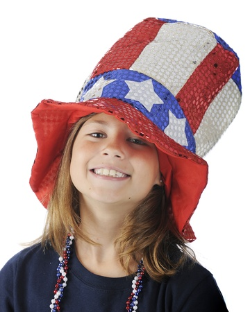 oversized: Close-up of a pretty elementary girl looking up from under a sparkly, oversized Uncle Sam hat   On a white background