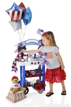 leis: An adorable preschooler selecting a pencil from her Fourth of July vendor stand.  The stands signs are left blank for your text.  On a white background.