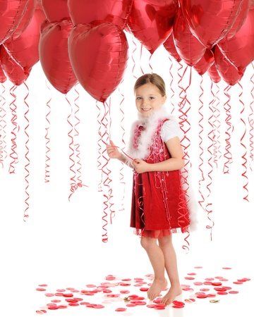 A beautiful elementary girl walking through a forest of heart shaped balloons.  On a white background. Stock Photo - 14089818