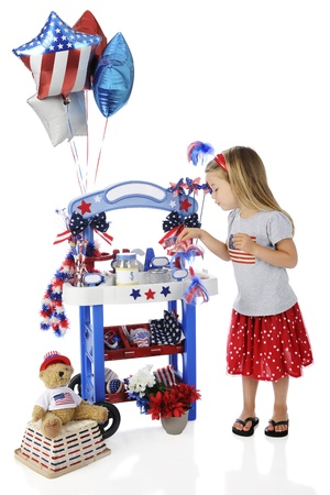 leis: An adorable preschooler checking her Fourth of July vendor stand   The stand