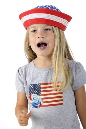 An adorable preschooler in American patriotic clothes   She photo