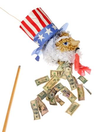 A broken Uncle Sam pinata  bleeding  money  Stock Photo