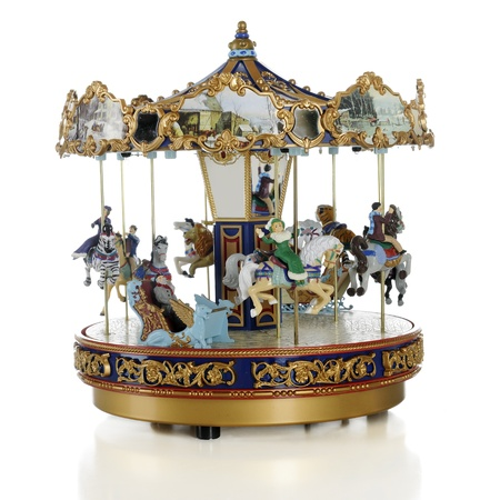 A model old-time carousel on a white background. Stock Photo