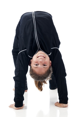 Front view of a beautiful elementary girl doing a gymnastics