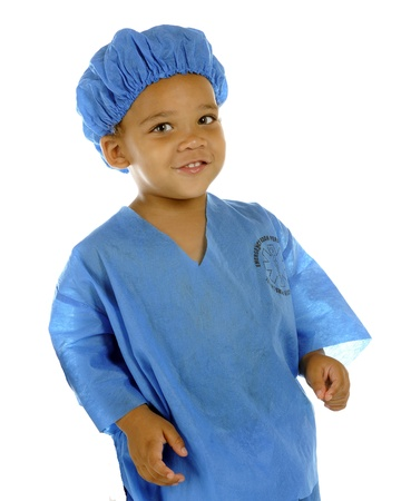 Portait of a tiny ER worker in blue scrubs   Taken on a white background Stock Photo - 14578004