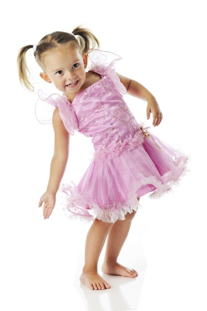 An adorable preschooler, barefoot in a frilly pink dress, arching her back in gesture.  On a white background. photo