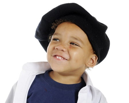 smock: Closeup image of an adorable preschool artist happily wearing his French beret and white smock with bits of red paint splattered on his face   On a white background