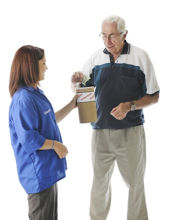 A senior man putting bills into a donation can held by a teen volunteer.  On a white background. photo
