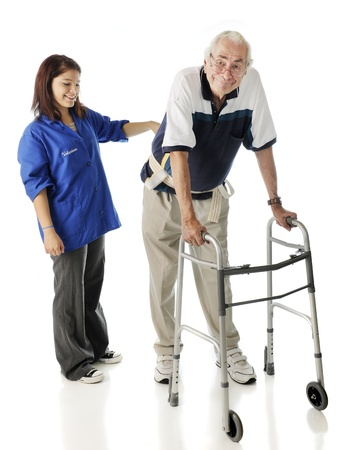 A young teen volunteer keeping an elderly man secure as he ambulates with his walker.  On a white background.