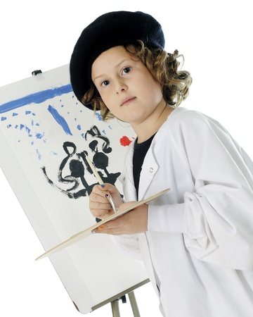 smock: A serious elementary girl kneeling as she paints on an easel in her French beret and white smock   On a white background