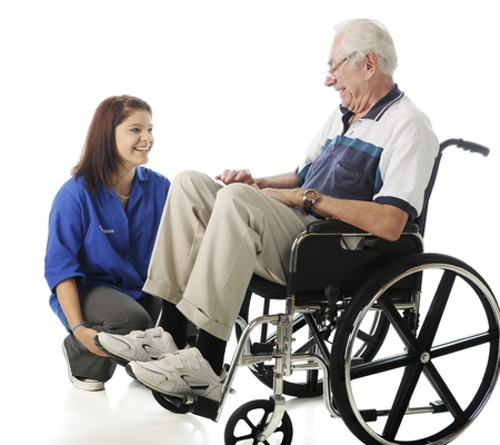 A teen volunteer and old man in a wheelchair talking and laughing together   On a white background