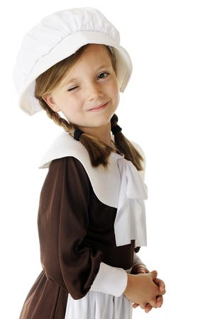 A beautiful little pilgrim winking at the viewer.  On a white background.