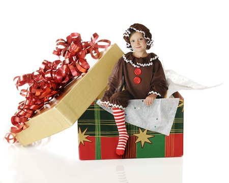 rick rack: An attractive elementary gingerbread girl emerging from a gift box of cookies   On a white background