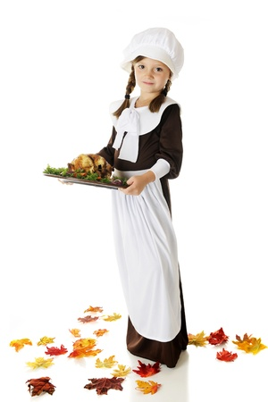 Full-length image of pretty elementary Pilgrim girl carrying a wooden plate of roast bird with veggies.  On a white background. Stock Photo - 15171779