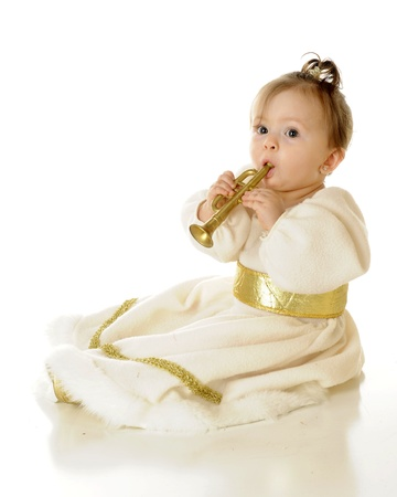 An adorable baby snow princess blowing a tiny toy trumpet.  On a white background. photo