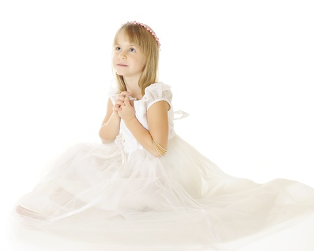 A beautiful elementary girl sitting in a flowing, white dress looking heaveward with her hands clasped.  She wears a wreath of pink pearls on her head.  On a white background.